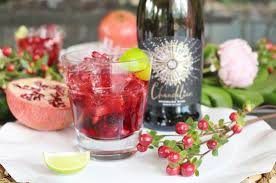 ½ lime cut into wedges ½ oz pomegranate juice 10 fresh pomegranate seeds 1 tsp superfine sugar 2oz cachaca 3oz chandelier italian sparkling wine