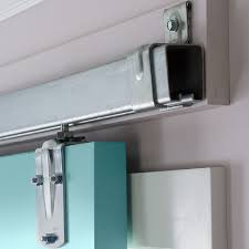 instead of fastening the barn door rail to drywall first a ledger board to the wall studs for a sturr mounting surface that allows