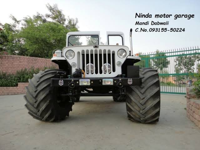 open jeep modified in black colour
