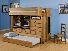 wooden bunk beds with desk and trundle