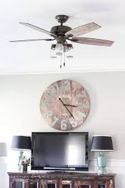 here in the south a ceiling fan is a necessity girl it is hot but despite the bad rap that ceiling fans can get there are some really cute farmhouse