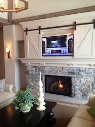 tv on fireplace mantel marvelous 50 ways to use interior sliding barn doors in your home