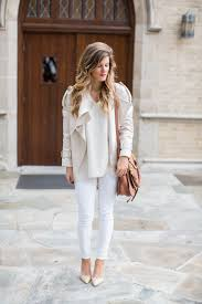 winter white outfit with white jeans cream sweater chloe bag patent pumps