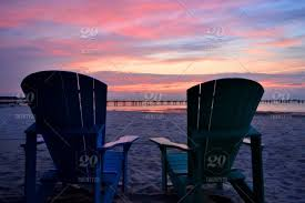 Adirondack chairs on beach sunset Lantern Press nominated Adirondack Chairs Silhouetted Against Sunrise Over The Chesapeake Bay Copy Space Background Commercial Clearance Travel Destination Twenty20 Nominated Adirondack Chairs Silhouetted Against Sunrise Over The