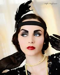 with cropped hair heavy makeup and a short dress the flapper of the 1920s