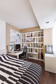 bedroom office desk. This Bedroom Features A Wide Bed With Plenty Of Space For Lounging And Sleeping. Beyond Office Desk