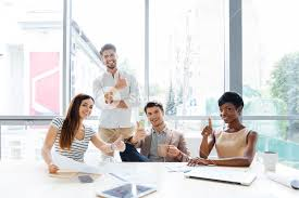 Cheerful Successful Multiethnic Group Of Young Business