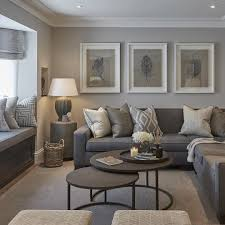 White frames above dark grey sofa