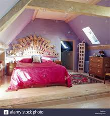 Mauve Bedroom Large Wooden Carving Above Bed With Pink Bedcover In Mauve Attic