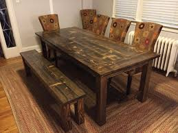 dining table with bench solid wood. solid wood farmhouse table with stretchers and breadboards. matching wooden bench. distressed dark walnut dining bench a