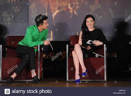 Chinese actor Wen Zhang, left, and Tianwanese actress Shu Qi communicate  during a press conference for their latest movie, Odyssey, in Beijing, 27  Dec Stock Photo - Alamy