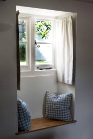 Cottage window seat ~ so cute, love the dormer rod curtains