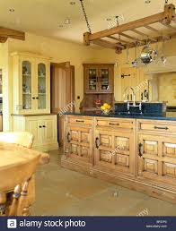 yellow country kitchens. Yellow Country Kitchens Hanging Wooden Utensil Rack Above Island Unit In  Traditional Kitchen With Chestnut Wood Yellow Country Kitchens