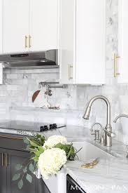White kitchen Wood Floor White Kitchen With Carrara Countertops And Farmhouse Sink Maison De Pax Good Housekeeping Gray And White And Marble Kitchen Reveal Maison De Pax