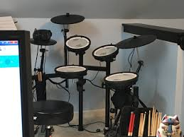 work and taking care of our special needs child i don t get to play that often but i like having my electronic drum kit in line of sight from my desk