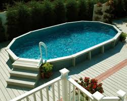 above ground pool with deck surround. This Above-ground Pool Has A Wooden Deck Surrounding It. The Does Not Above Ground With Surround I