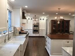 White Kitchen With Hardwood Floors Historic Kitchen With Carrara Marble Perimeter Countertops And A