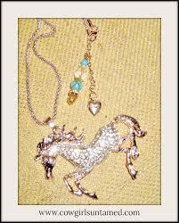 large golden rhinestone horse pendant