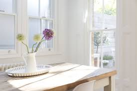 natural lighting in homes. flowers in vase on wooden table with natural light lighting homes