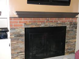 redo a brick fireplace with stone ideas