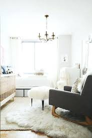 the power of this home accessory is wildly underrated nursery decor rugs white rug fur another beige and white nursery