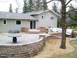 Raised Paver Patio with Retaining Walls Stairs Deck and Seating