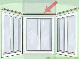 how to hang curtains in a bay window image titled hang curtains in a bay window