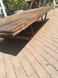 coffee table of old factory cart with nicely patinated wood