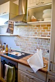 Small Kitchen With Painted Fau Brick Backsplash Pudel Design Featured On  @remodelaholic