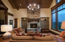 wrought iron chandelier living room rustic with arch cream walls dark wood floor dark