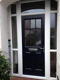 2 panel 1 grill composite front door in blue with a top light and within doors