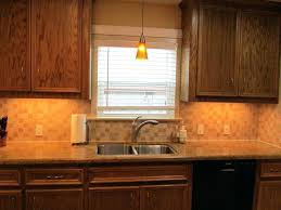 hanging pendant light over kitchen sink the makeovers dining lights modern lighting placement of