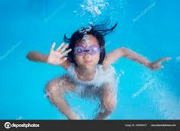 picture cute little looks happy while swimming underwater swim stock photo