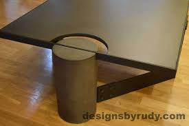 black concrete coffee table black steel frame full round leg side view no