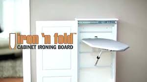 fold iron board charming white wooden cabinet fold down ironing board combine with light purple wall