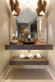 Fabulous feature wash basin wall lights give great lighting for the face.  LED linear lighting under the vanity unit and a mini downlight in the niche  about ...