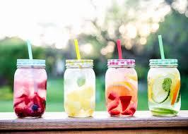 fruit water in mason jar cups