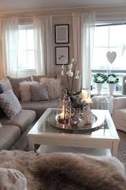 Modern Grey Living Room With Cozy Fur Pillows And Throws, Pretty Candles  And Flowers On The Coffee Table Tray Awesome Ideas