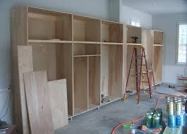 unfinished custom diy homemade wood garage storage cabinet for garage makeover design with concrete floor tiles ideas