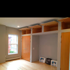 Bedroom with built in high ceiling storage and alcove for bed frame-  #PortlandRenovations Carrol