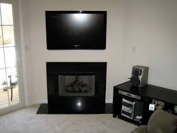 installing flat screen tv on wall over fireplace best image