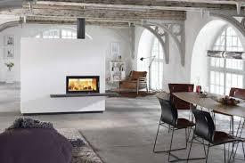 Camini classici e moderni: come arredare casa con il fuoco [foto