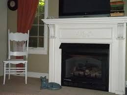 see the striking marble fireplace in this transitional gray living room at white brick wood mantel