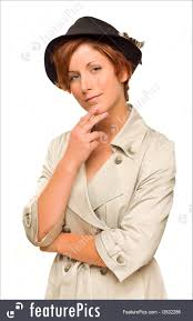people attractive red haired girl wearing a trench coat and hat isolated on a white