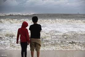 Isabella Roberson and Stanely Roberson look out at the waves crashing...  News Photo - Getty Images