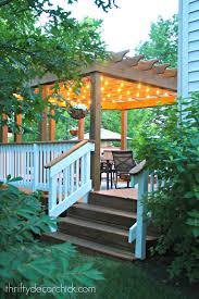 Pergola String Lights How To Hang Outdoor String Lights From Thrifty Decor Chick