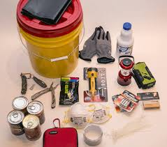 contents of a shelter in place kit bucket garbage bags gloves chlorine bleach rope knife multi tool glowsticks flashlight battery powered lantern