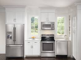 White Kitchen Decor with Silver Refigerator Cover and Stove with White  Kitchen Cabinets and Wood Kitchen
