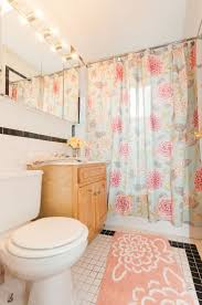 The perfect girly bathroom. Great lighting, pastel colors, and floral  print. This