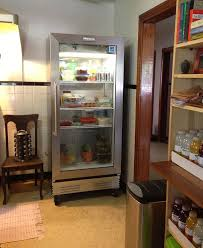Glass Front Refrigerator for Home Showcasing Shop Style in Private Retreat